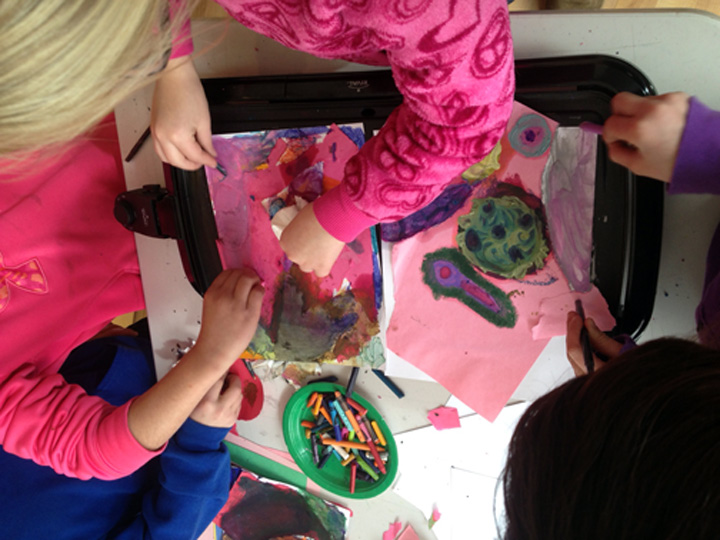 Current Exploration project encouraged students to create compositions through subtractive ripping of paper, then adding colorful melted wax.