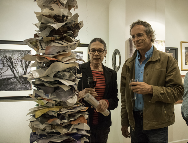 Candace Miller & gallery guest with Lauri Sturdivant's recycled work